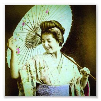 Geisha japonés del vintage que presenta el parasol fotografías