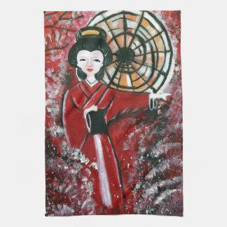 Geisha japonés en un vestido rojo toalla de cocina