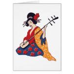 Geisha japonés que toca un instrumento de Shamisen Tarjetas