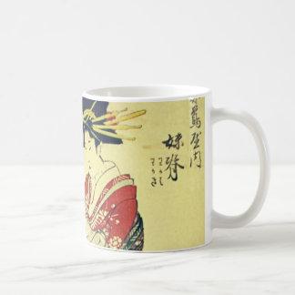 Geisha y el pequeño taza clásica