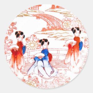 Geishas en jardín pegatina redonda