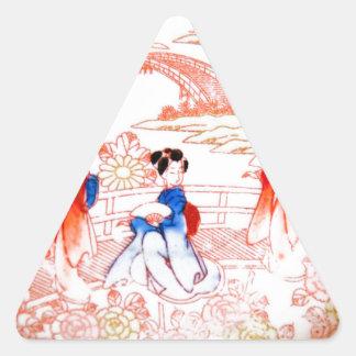 Geishas en jardín pegatina triangular