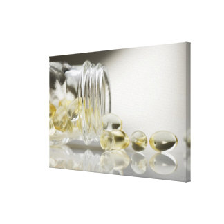 Gelcaps spilling out of glass bottle gallery wrap canvas