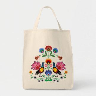 Gente polaca con floral decorativo y los pollos bolsa de mano