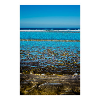 gentle soft waves lashing onto sandy beach poster