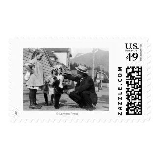 Gentleman and Kids Playing with Bear Cub On Leas Postage