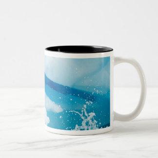 gentoo penguin, Pygoscelis Papua, jumping off an Two-Tone Coffee Mug