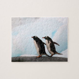 Gentoo penguins on rocky shoreline with backdrop 2 jigsaw puzzle