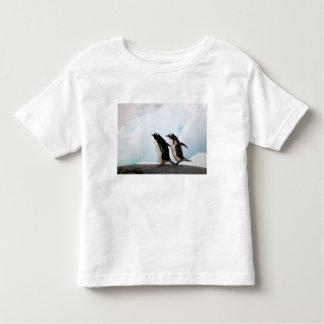Gentoo penguins on rocky shoreline with backdrop 2 toddler t-shirt