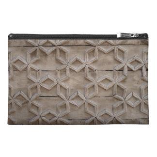Geometric pattern in wood bag travel accessory bag