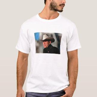 George W. Bush - dressed in black wearing a cowboy T-Shirt