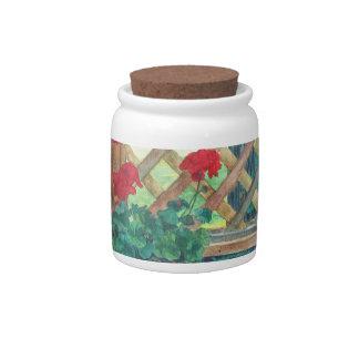 Geranio en la cubierta jarras para caramelos