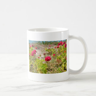 Geranios rojos salvajes tazas de café