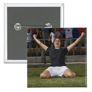 German female soccer player celebrating goal 2 inch square button