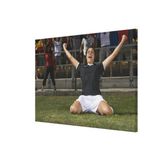 German female soccer player celebrating goal canvas print
