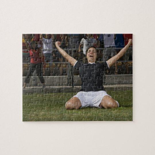 German female soccer player celebrating goal jigsaw puzzle