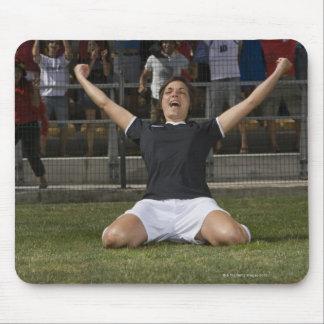 German female soccer player celebrating goal mouse pad