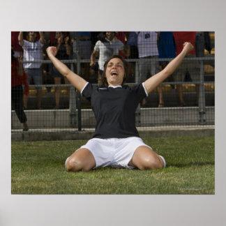 German female soccer player celebrating goal poster