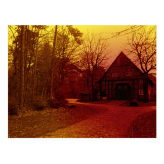 german mystical town house in forest red tint postcard