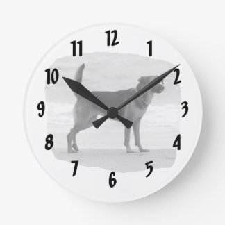 German Shepherd bw beach stand tongue out Round Clock