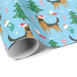 "German Shepherd Christmas Wrapping Paper<br><div class=""desc"">This Christmas wrapping paper is perfect for any German Shepherd lover! The design features a German Shepherd with a Santa hat, a Christmas tree with dog treat ornaments, a stocking filled with dog treats, a dog treat cookie and a glass of milk for ""Santa Paws, "" and other Christmas elements....</div>"