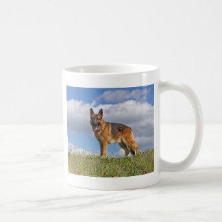 German Shepherd on Hill Mugs