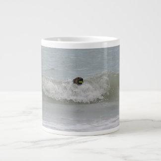 german shepherd swimming in wave giant coffee mug