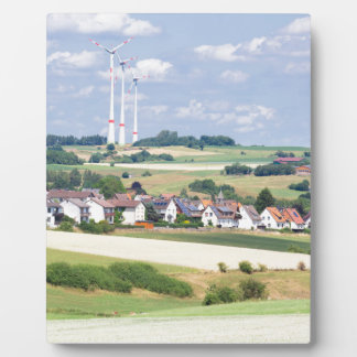 German village houses windmills and corn fields plaque