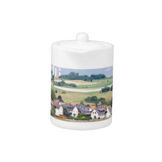 German village houses windmills and corn fields teapot