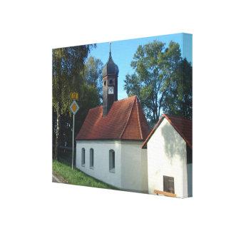 Germany, Bavaria, Rural church with onion spire Canvas Print