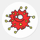 Germen rojo del dibujo animado pegatina redonda