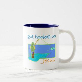 Get enganchó en el pescador de Jesús Taza