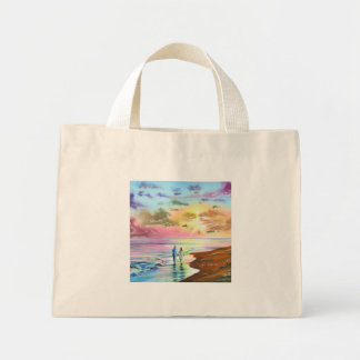 Getting our feet wet sunset beach painting mini tote bag