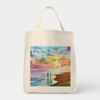 Getting our feet wet sunset beach painting tote bag
