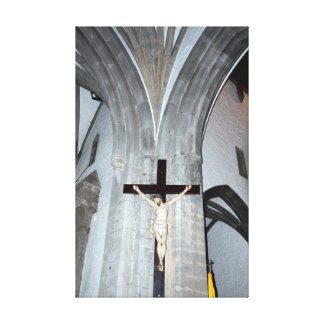 giant crucifix of Christ on the wall Canvas Print