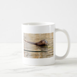 Giant otter swimming in water coffee mug