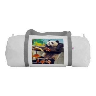 Giant panda baby over the tree gym bag