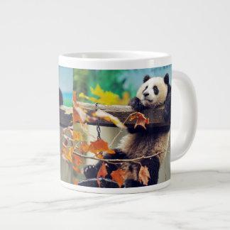 Giant panda baby over the tree large coffee mug