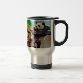 Giant panda baby over the tree travel mug