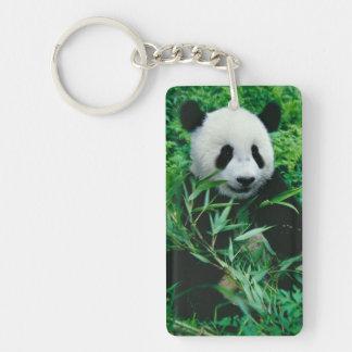 Giant Panda cub eats bamboo in the bush, Keychain