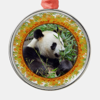 Giant panda eating bamboo in frame round metal christmas ornament
