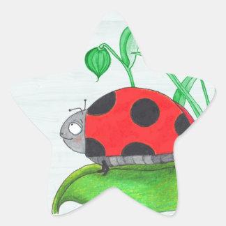 Giant red ladybug on a leaf star sticker