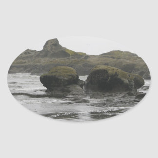Giant Rocks on Shore Oval Sticker