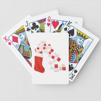 Giftboxes que se derrama fuera de una media cartas de juego