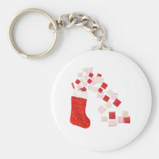 Giftboxes spilling out of a stocking basic round button keychain