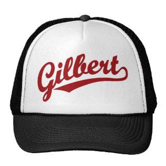 Gilbert script logo in red trucker hat