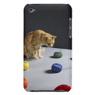 Ginger tabby cat sitting on table barely there iPod cover
