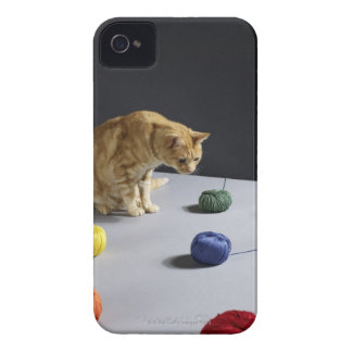 Ginger tabby cat sitting on table iPhone 4 Case-Mate case