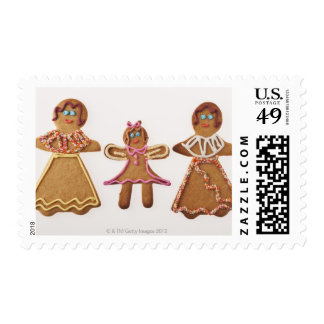 Gingerbread family. Against white background. Postage
