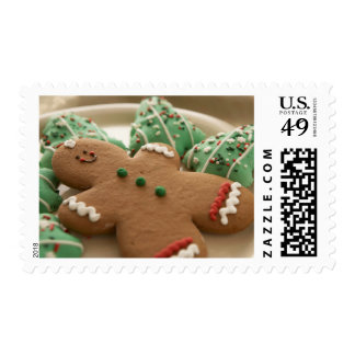 Gingerbread man and Christmas cookies on plate Postage